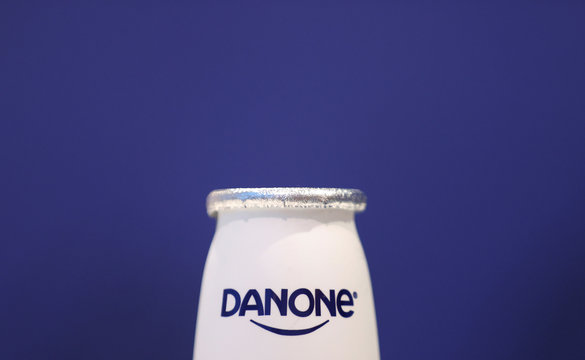 A company logo is seen on a product displayed before French food group Danone's 2019 annual results presentation in Paris
