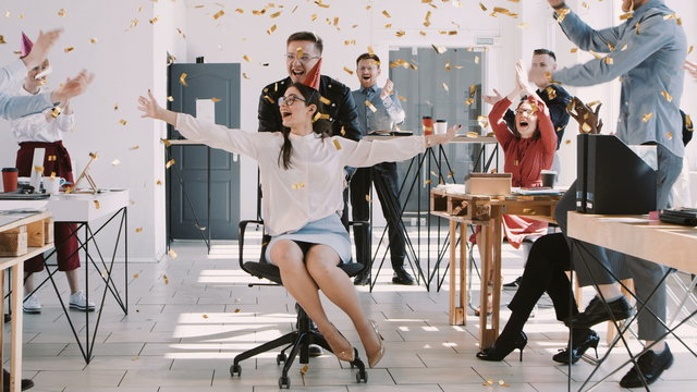 RED EPIC-W Happy fun young brunette business woman celebrating birthday at party with office colleagues slow motion.