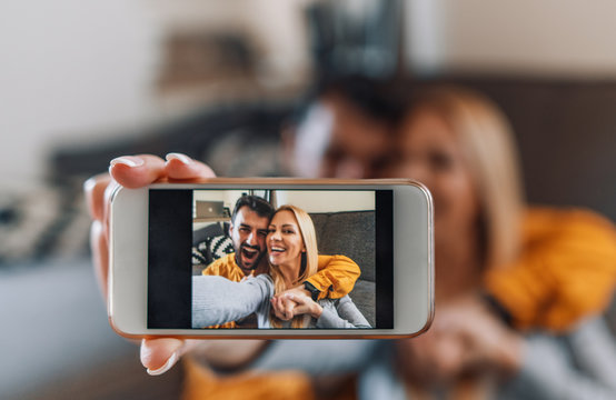 Young couple at home,take selfie