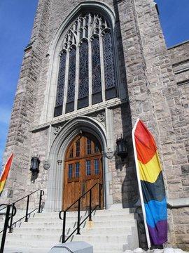 Rainbow banner welcomes LGBTQ parishoners to a Gothic church