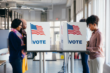 Diverse Women Voting on Election Day