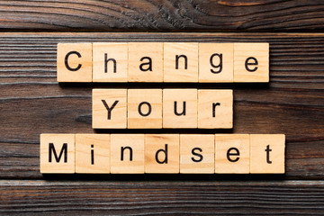 Change your mindset word written on wood block. Change your mindset text on wooden table for your desing, Top view concept