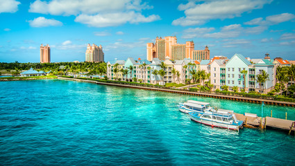 Wall Mural - Skyline of Paradise Island with colorful houses at the ferry terminal. Nassau, Bahamas.