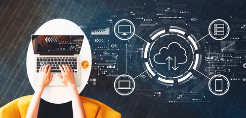 Wall Mural - Cloud computing with person using a laptop on a white table