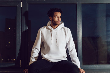 Attractive african american man in hoodie sweater. Mock-up.