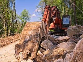 Excavator loader machine at road construction site.