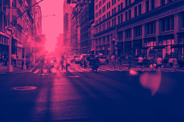 Fotomurales - Crowds of people crossing a busy intersection in Manhattan New York City with pink and blue color effect
