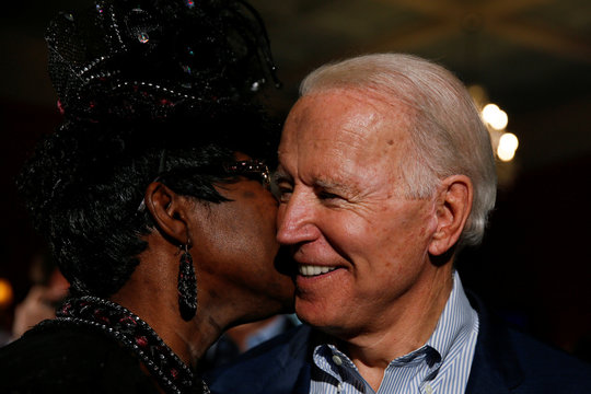 Denise Washington of Georgetown whispers into the ear of Democratic U.S. presidential candidate and former U.S. Vice President Biden during a campaign event in Georgetown