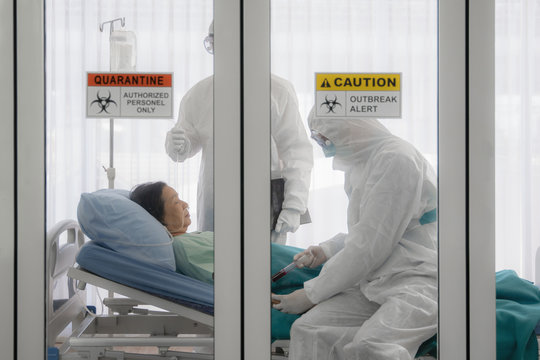 coronavirus covid-19 infected patient on bed in quarantine room with quarantine and outbreak alert sign at hospital with disease control experts make disease treatment, coronavirus outbreak control