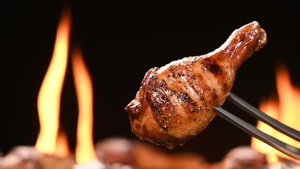 Fototapete - Close up grill roast bbq chicken leg on the flaming grill . HD slow motion .
