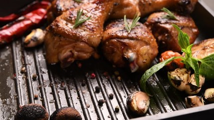 Wall Mural - Close up grill roast bbq chicken leg with addition herbs and spices on the frying pan .