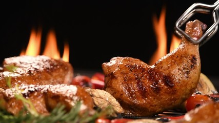 Fototapete - Close up grill roast bbq chicken with addition herbs and spices on the on the flaming grill . 4k