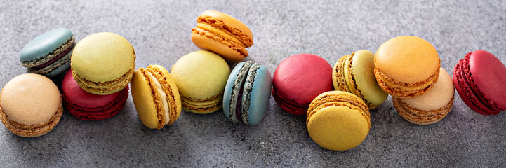 Foto op Textielframe Macarons Variety of colorful macarons on the table, french dessert