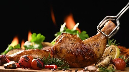 Wall Mural - Close up grill roast bbq chicken with addition herbs and spices on the on the flaming grill . 4k
