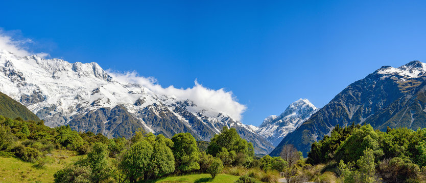 Panoramic high mountain views on the top of the mountain are white snow in the summer with blue sky in Mount Cook National Park in southern island  of New Zealand.