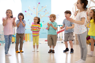 preschool kids group have fun playing at kindergarden