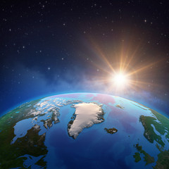 Wall Mural - Sun shining over Artic and Greenland from space
