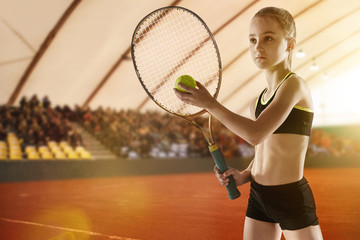 Little caucasian girl playing tennis on sport court background. Cute model training, practicing in motion, action. Youth, flexibility, power and energy. Movement, ad, sport, healthy lifestyle concept.