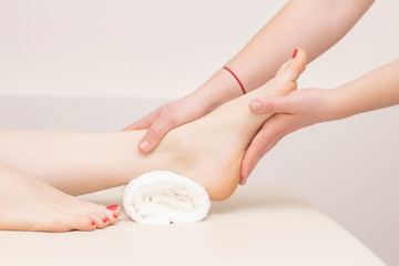 Foot massage in spa salon, closeup. foot massage relax skin care. Therapeutic pedicure.