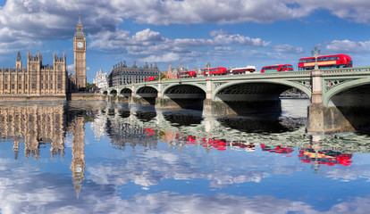 Fototapete - Big Ben and Houses of Parliament with red buses on the bridge in London, England, UK