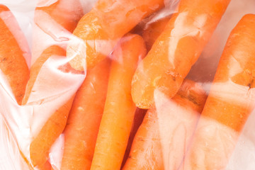 Bunch of organic Carrots, wrapped in plastic