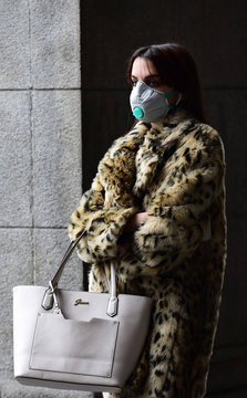 Woman wears a protective mask, as a coronavirus outbreak continues to grow in northern Italy, in Turin