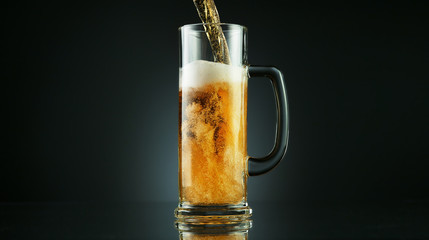 Wall Mural - Freeze motion of pouring beer into glass pint