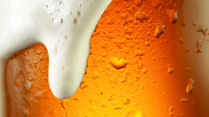 Wall Mural - Detail of beer drink with overflowing foam head