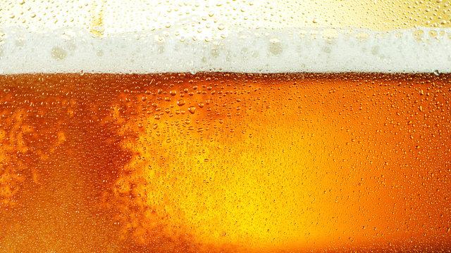 Detail of beer drink with foam head