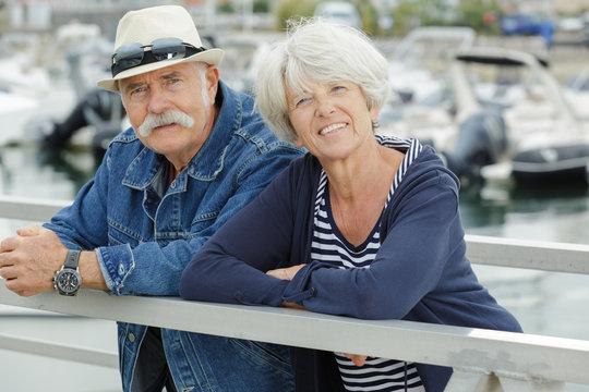 senior couple walking near the sea