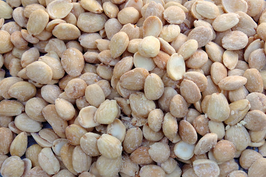 High angle full frame close-up view of lightly salted and roasted Marcona almonds from Spain