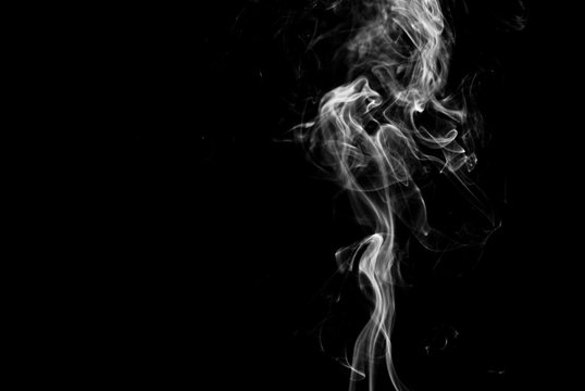 Picture of white cigar smoke in black view