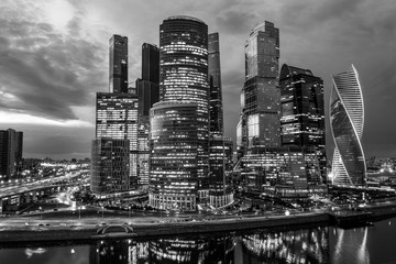 Printed kitchen splashbacks Moscow Business district of the city. Night photography of the financial center of Moscow. Skyscrapers shimmering with colorful lights. Reflection in the water of the river.