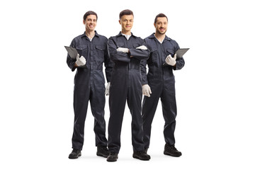 Three mechanic workers in uniforms