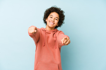 African american little boy isolated cheerful smiles pointing to front.