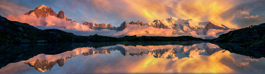 Mountains reflected on a lake in the French Alps, Chamonix at sunrise