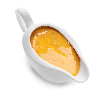Gravy boat of tasty honey mustard sauce on white background