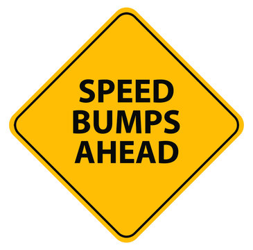 speed bumps ahead sign on white background