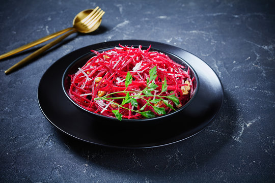 Fresh salad of raw julienned beetroot with nuts