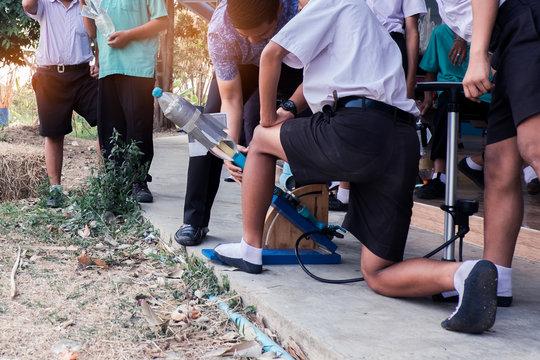 Uniform students and teacher keep Water Bottle Rocket