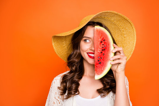 Photo of casual cheerful brown haired nice charming pretty sweet girlfriend smiling toothily beaming looking away covering half of face with wedge of water melon isolated vivid color background