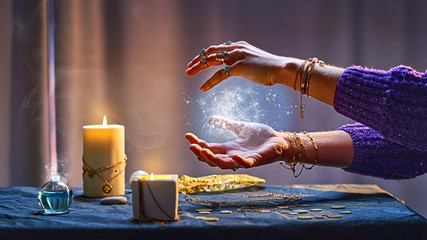 Magical luminous swirling glowing ball in the palm of a witch wizard woman during a witchcraft and occult esoteric spiritual ritual. Magic and sorcery