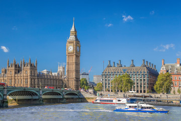 Fototapete - Big Ben and Houses of Parliament with boats on the river in London, England, UK