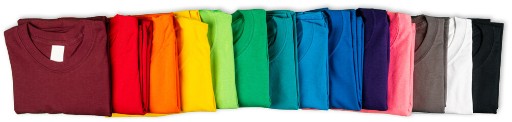 wide panorama banner row of many fresh new fabric cotton t-shirts in colorful rainbow colors isolated. Pile of various colored shirts white background. diy printing fashion concept. Wall mural
