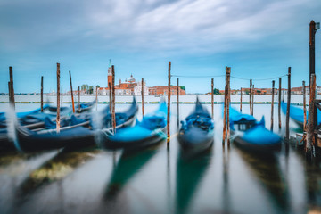 Keuken foto achterwand Gondolas Motion of Gondolas floating in the Grand Canal withfocus on San Giorgio Maggiore church in background