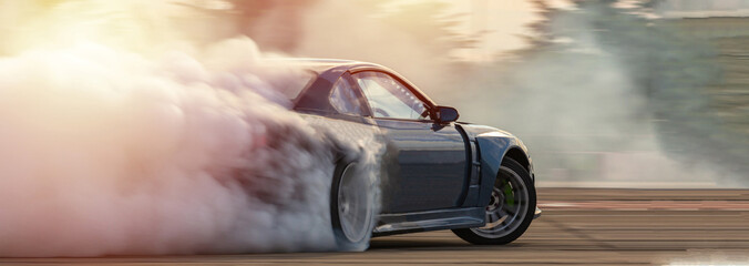 Car drifting, Blurred  image diffusion race drift car with lots of smoke from burning tires on speed track. Fototapete
