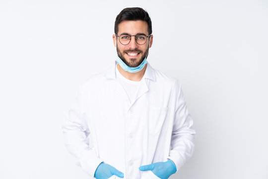Caucasian dentist man over isolated background
