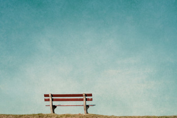 empty bench in an empty blue background Wall mural