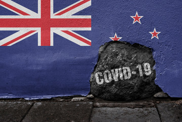 Flag of New Zealand on the wall with cracked stone with Coronavirus name on it. 2019 - 2020 Novel Coronavirus (2019-nCoV) concept, for an outbreak occurs in New Zealand.