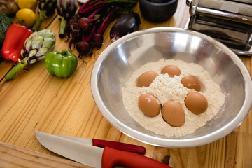 Salad bowl with flour and eggs inside